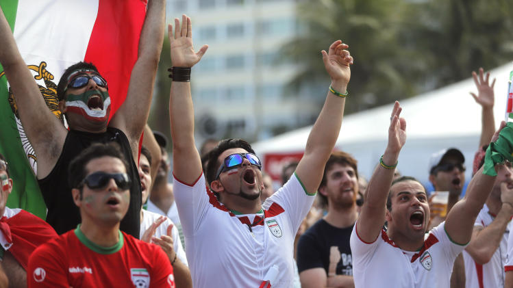 Iran soccer fans react as they watch a live telecast of their team's World Cup game with Argentina inside the FIFA Fan Fest area on Copacabana beach in Rio de Janeiro, Brazil, Saturday, June 21, 2014. Argentina won 1-0. (AP Photo/Silvia Izquierdo)