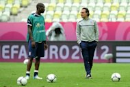 Italian headcoach Cesare Prandelli (R) speaks with Italian forward Mario Balotelli on as he takes part in a training session of the Italy's national football team. Balotelli still needs to learn that team-work can be a weapon, according to Prandelli