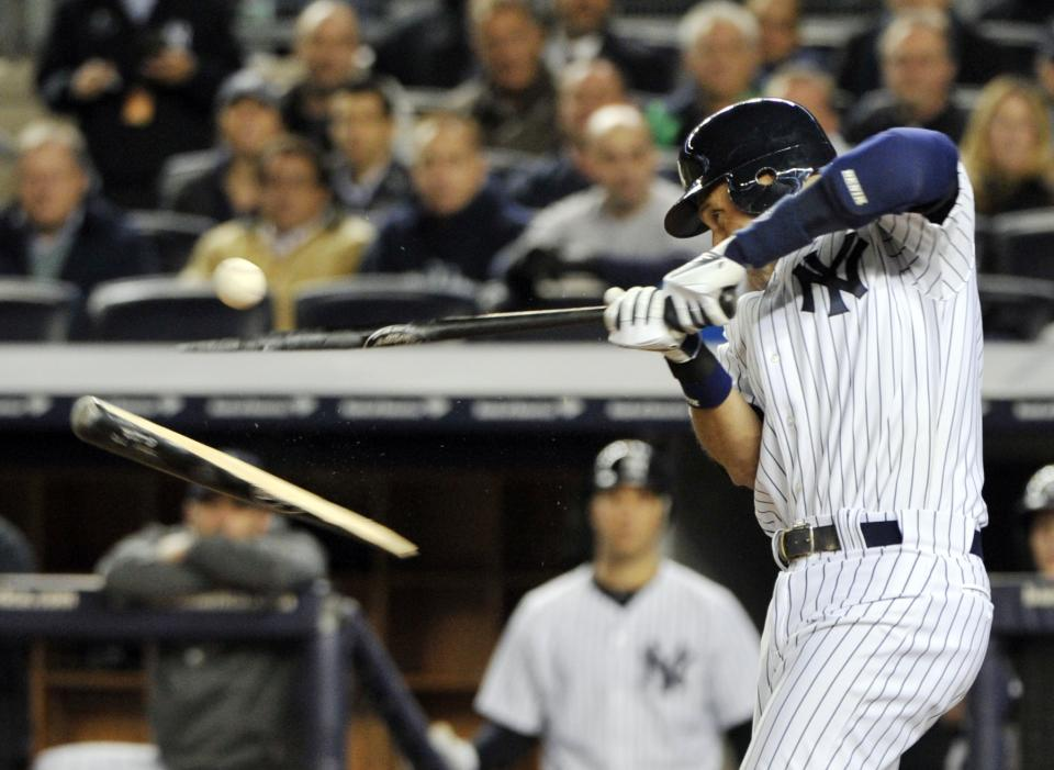 New York Yankees' Derek Jeter breaks his bat during the third inning of Game 4 of the American League division baseball series against the Baltimore Orioles, Thursday, Oct. 11, 2012, in New York. (AP Photo/Bill Kostroun)