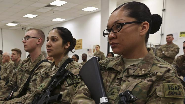 U.S. troops attend a ceremony to mark International Women's Day at a NATO base in Kabul