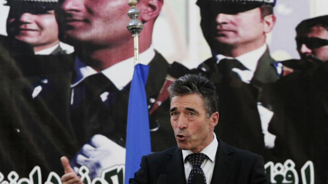 NATO Secretary General Anders Fogh Rasmussen speaks at a press conference during a ceremony at a military academy on the outskirts of Kabul, Afghanistan, Tuesday, June 18, 2013. Afghan forces have taken over the lead from the U.S.-led NATO coalition for security nationwide, Afghan President Hamid Karzai announced in the significant milestone in the 12-year war. (AP Photo/Rahmat Gul)