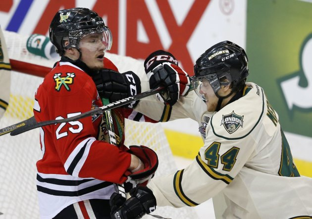 Portland Winterhawks' Peters and London Knights' Mermis battle for position during the Memorial Cup Canadian Junior Hockey Championships in Saskatoon.
