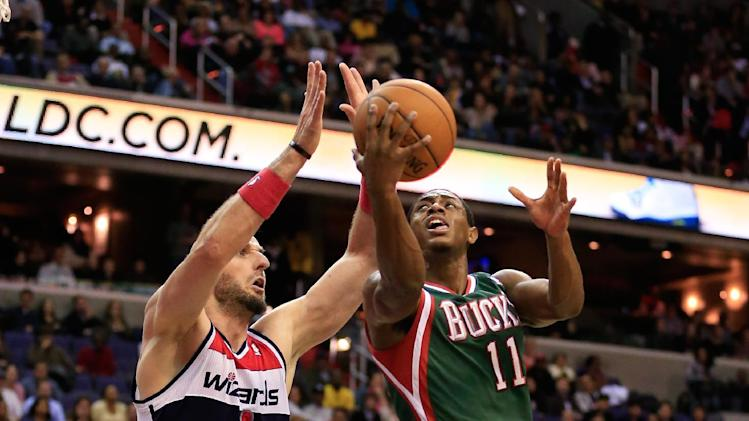 Middleton scores 29 as Bucks beat Wizards in OT