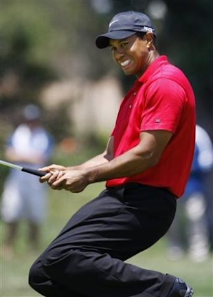 FILE - This June 16, 2008, file photo shows Tiger Woods reacting after missing a birdie putt on a sudden death hole following an 18-hole playoff round