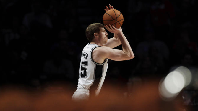Matt Bonner of the San Antonio Spurs shoots during the 3-point contest during NBA basketball All-Star Saturday Night, Feb. 16, 2013, in Houston. (AP Photo/Eric Gay)