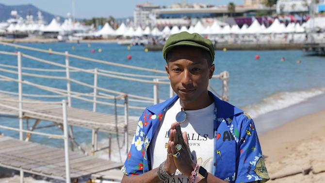 Pharrell Williams poses for photographers during a photo call for the film Dope, at the 68th international film festival, Cannes, southern France, Friday, May 22, 2015. (Photo by Joel Ryan/Invision/AP)
