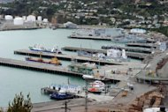 This file photo shows a general view of Lyttelton port in New Zealand. All 43 crew from the stricken N.Zealand fishing trawler Amaltal Columbia arrived safely on shore on Wednesday telling of a &quot;scary&quot; ordeal as a fire swept through their ship