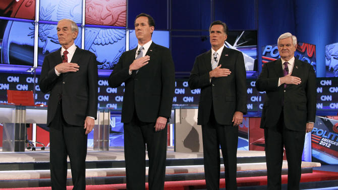 Republican presidential candidates, from left, Rep. Ron Paul, R-Texas, former Pennsylvania Sen. Rick Santorum, former Massachusetts Gov. Mitt Romney and former House Speaker Newt Gingrich stand for the National Anthem before the start of a Republican presidential debate Wednesday, Feb. 22, 2012, in Mesa, Ariz.  (AP Photo/Ross D. Franklin)