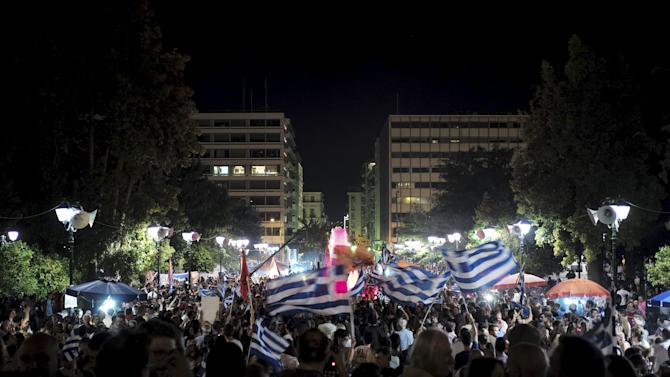 """No"" supporte""No"" supporters wave Greek national flags during celebrations in Athens, Greece"