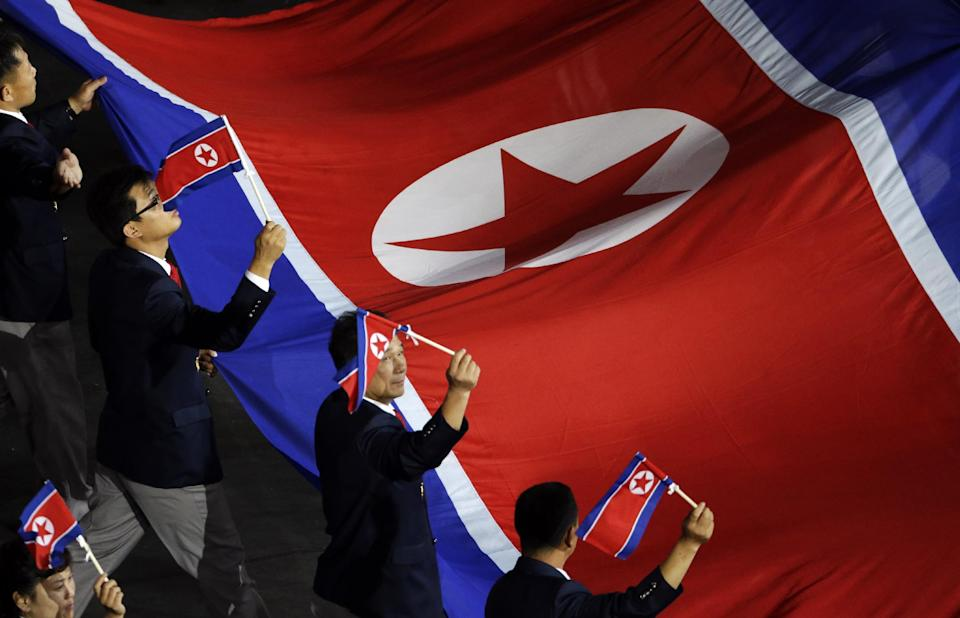 The North Korean Olympic team arrives during the Opening Ceremony at the 2012 Summer Olympics, Friday, July 27, 2012, in London. (AP Photo/Charlie Riedel)