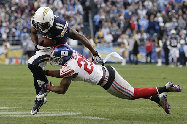 San Diego Chargers wide receiver Eddie Royal, left, gets past New York Giants strong safety Antrel Rolle, right, in the second half of an NFL football game on Sunday, Dec. 8, 2013, in San Diego