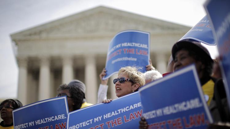 Supporters of health care reform rally in front of the Supreme Court in Washington, Wednesday, March 28, 2012, on the final day of arguments regarding the health care law signed by President Barack Obama. (AP Photo/Charles Dharapak)