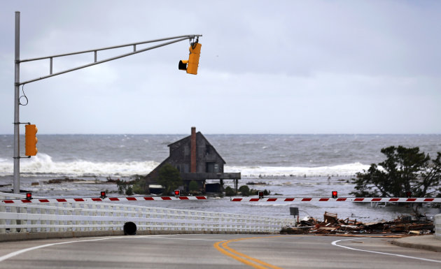A lone home sits on the beach in an area that residents say was filled with homes but are now gone the morning after superstorm Sandy rolled through, Tuesday, Oct. 30, 2012, in Mantoloking, N.J. Debri