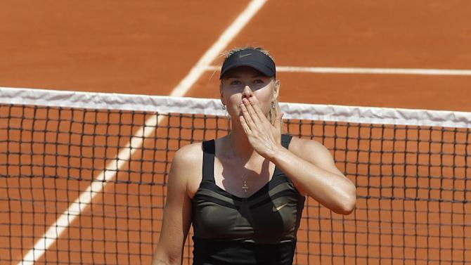 Maria Sharapova of Russia throws a kiss to spectators after winning her first round match against Alexandra Cadantu of Romania at the French Open tennis tournament in Roland Garros stadium in Paris, Tuesday May 29, 2012. Sharapova won in two sets 6-0, 6-0. (AP Photo/Michel Euler)