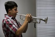 A Mexican musician plays his trumpet during an entrance examination at Ollin Yolitzli Mariachi Music School in Mexico City on September 25. The mariachi school, the first one in Mexico City, will open next October