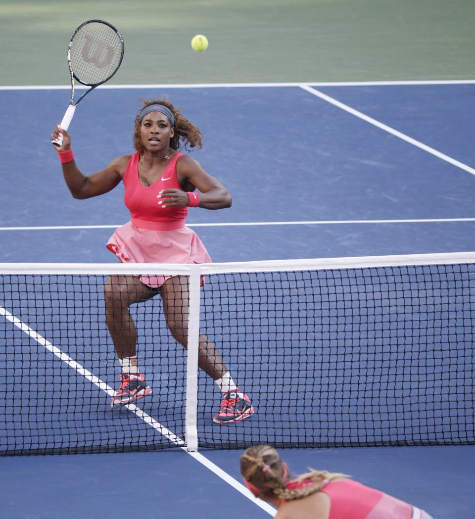 Serena Williams returns a shot to Victoria Azarenka, of Belarus, during the women's singles final of the 2013 U.S. Open tennis tournament, Sunday, Sept. 8, 2013, in New York. (AP Photo/Kathy Willens)