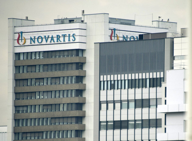 FILE - This Oct. 25, 2011 file photo shows the logo of Swiss pharmaceutical company Novartis AG on one of their buildings in Basel, Switzerland. Novartis AG says Thursday, July 19, 2012 its net profit during the second quarter reached US dollar 2.73 billion. This is the same as for the previous year's quarter. Novartis says sales fell four percent to US dollar 14.3 billion from US dollar 14.92 billion in the second quarter of 2011. (AP Photo/Keystone, Georgios Kefalas, File).