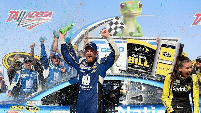 Dale Earnhardt Jr. celebrates in Victory Lane after winning the Talladega 500 NASCAR Sprint Cup Series auto race at Talladega Superspeedway, Sunday, May 3, 2015, in Talladega, Ala. (AP Photo/David Tulis)