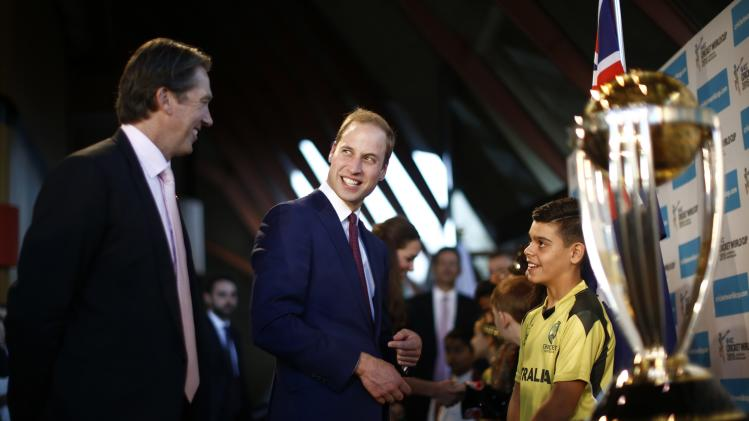 Britain's Prince William looks at former Australian cricketer McGrath during a reception at the Sydney Opera House
