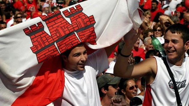 A man waves a flag of Gibraltar, whose UEFA membership had been opposed by Spain (REUTERS)