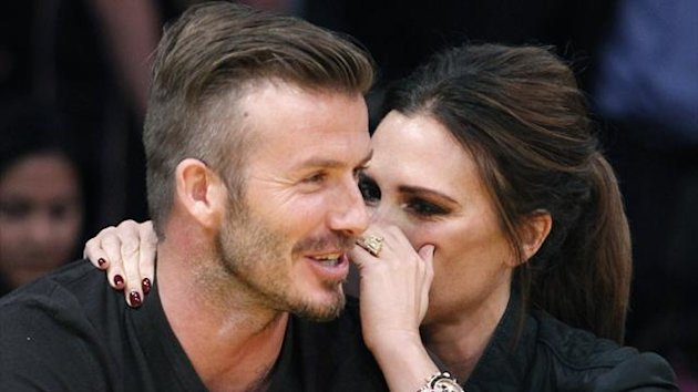David Beckham and his wife Victoria (Reuters)