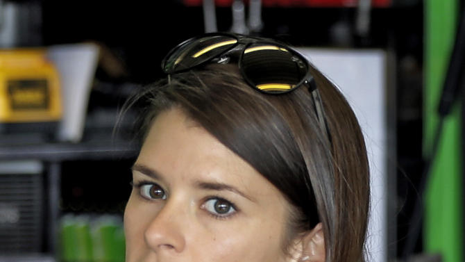 Danica Patrick looks out of the garage during practice for the NASCAR Sprint Cup Series Daytona 500 auto race Saturday, Feb. 23, 2013, at the Daytona International Speedway in Daytona Beach, Fla. (AP Photo/Chris O'Meara)