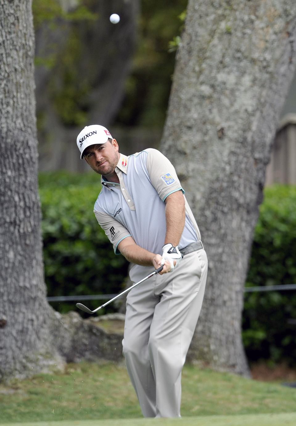 Graeme McDowell, of Northern Ireland, chips onto the second green during the final round of the RBC Heritage golf tournament in Hilton Head Island, S.C., Sunday, April 21, 2013. (AP Photo/Stephen Morton)