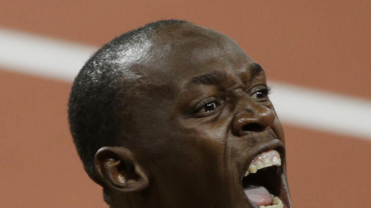 Jamaica's Usain Bolt yells after winning the men's 100-meter during the athletics in the Olympic Stadium at the 2012 Summer Olympics, London, Sunday, Aug. 5, 2012. (AP Photo/Matt Slocum)