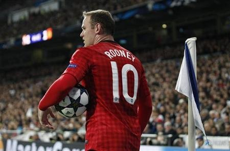Manchester United's Wayne Rooney prepares to take a corner during the Champions League soccer match against Real Madrid at Santiago Bernabeu stadium in Madrid