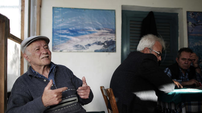 In this photo taken Sunday, March 24, 2013, Selcuk Ekendal, 72, speaks to The Associated Press inside a coffee shop in the Turkish Cypriot part of the divided capital Nicosia. Turkish Cypriots have been watching with fascination - and consternation - as the economy of their long prosperous southern brethren implodes. (AP Photo/Petros Giannakouris)