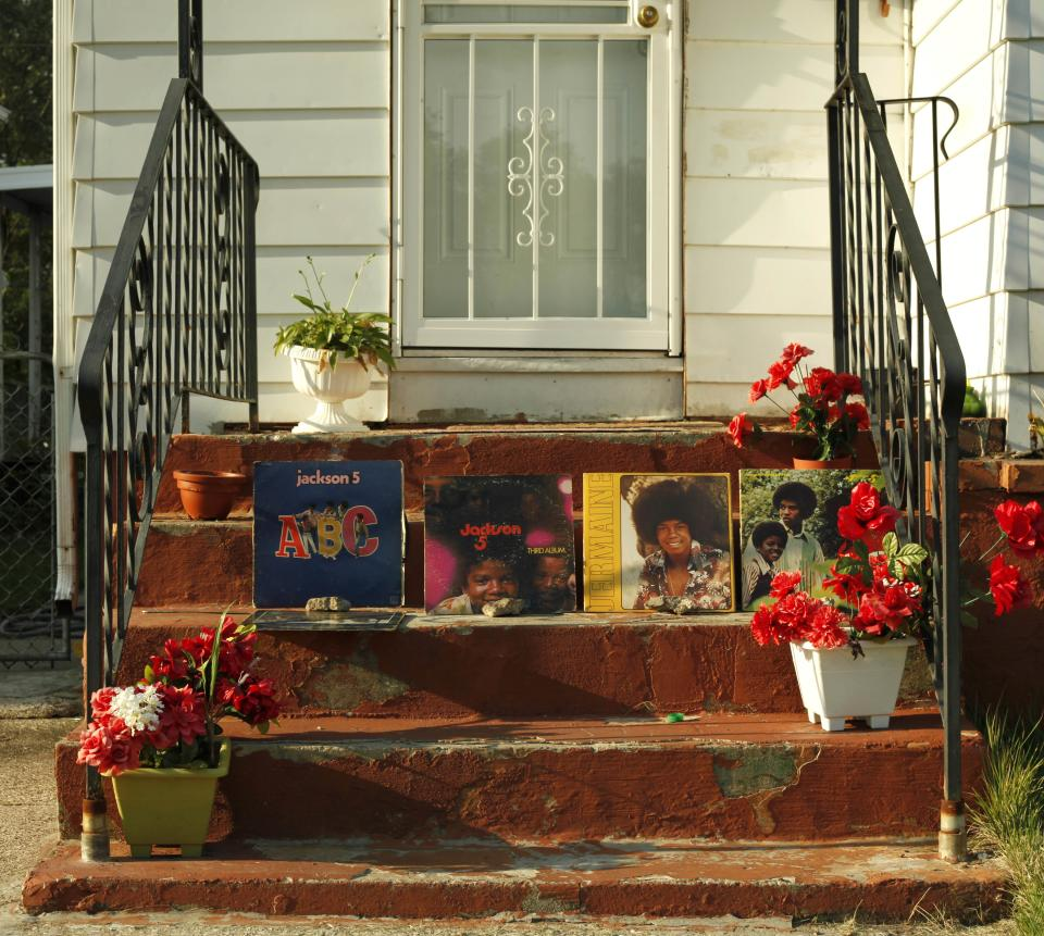 Autographed original Jackson 5 albums sit on display on the stairs of a home near Michael Jackson's boyhood home during celebrations marking what would have been Jackson's 54th birthday Wednesday, Aug. 29, 2012, in Gary, Ind. (AP Photo/Sitthixay Ditthavong)