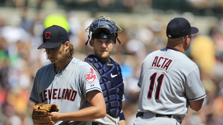 Cleveland Indians starting pitcher Chris Seddon, left, walks off the mound as catcher Lou Marson, center, and manager Manny Acta wait for a pitching change during the fifth inning of a baseball game against the Detroit Tigers in Detroit, Sunday, Aug. 5, 2012. (AP Photo/Carlos Osorio)