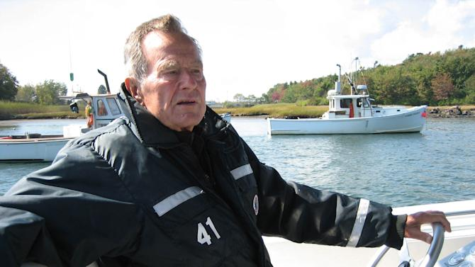 """This undated image released by HBO shows former President George H.W. Bush on his boat in Kennebunkport, Maine during the filming of the documentary """"41,"""" premiering Thursday, June 14, at 9:00 p.m. EST on HBO.  (AP Photo/HBO, Jeffrey Roth)"""