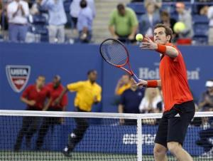 Security runs onto the court as Murray of Britain hits a ball into the crowd to celebrate defeating Istomin of Uzbekistan at the U.S. Open tennis championships in New York