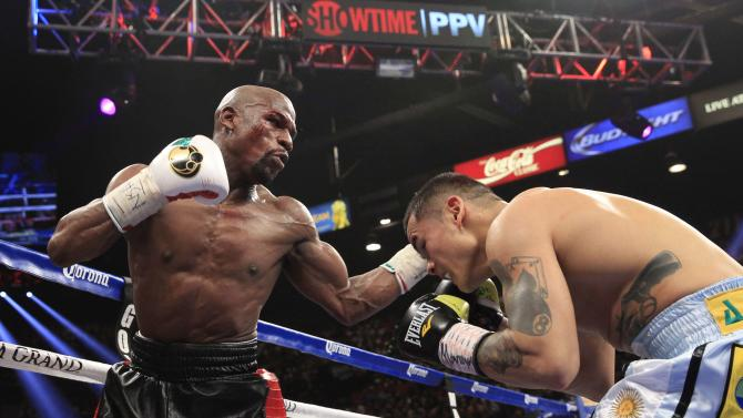 Mayweather Jr. punches at Maidana during their WBC/WBA welterweight unification fight at the MGM Grand Garden Arena in Las Vegas