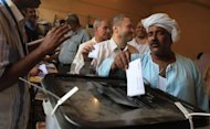 Egyptians cast their ballots at a polling station in Cairo. After a slow start, cooler evening temperatures and the end of the working day prompted a surge in voters who formed queues outside polling stations across the country