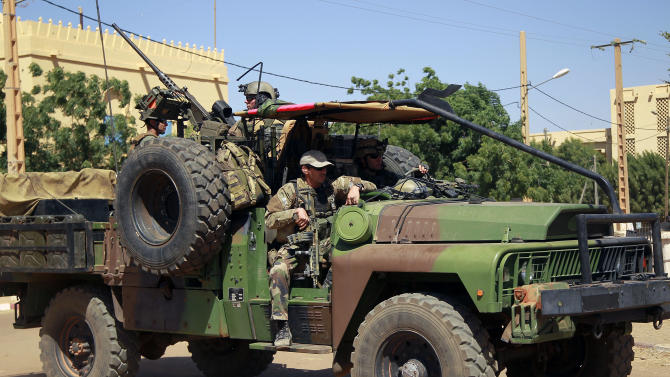 French special forces drive through Gao, Northern Mali, Wednesday Jan. 30, 2013. Islamist extremists fled the city Saturday after French, Chadian and Nigerien troops arrived, ending 10 month of radical Islamic control over the city.(AP Photo/Jerome Delay)