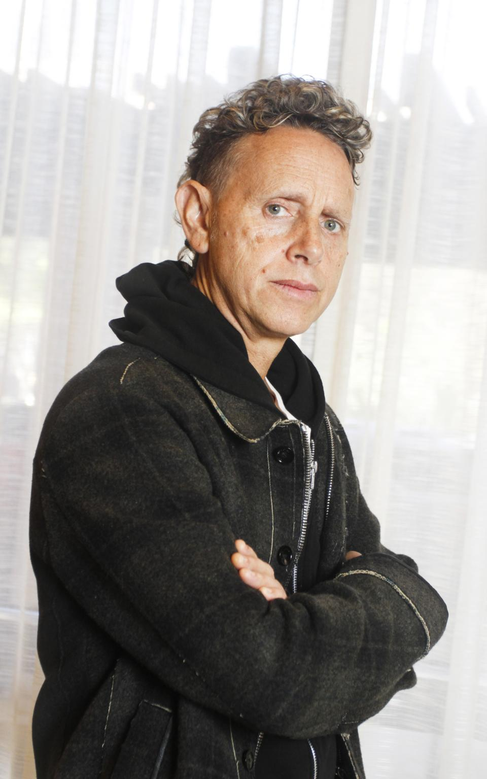 "In this March 13, 2013 photo, Martin Gore, of Depeche Mode, poses for a photograph during the SXSW Music Festival, in Austin, Texas. Depeche Mode's dark, electronic grooves are all over ""Delta Machine,"" the trio's 13th release, out this week. (Photo by Jack Plunkett/Invision/AP)"