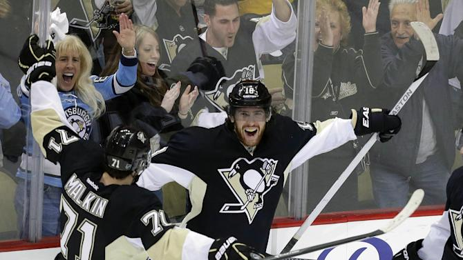 Pittsburgh Penguins' James Neal (18) celebrates with teammate Evgeni Malkin (71) after his third goal of the game during the third period in Game 5 of the Eastern Conference semifinals in their NHL hockey Stanley Cup playoffs series against the Ottawa Senators, Friday, May 24, 2013 in Pittsburgh. The Penguins won 6-2 to win the series four games to one. (AP Photo/Gene J. Puskar)