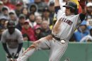 Cleveland Indians' Asdrubal Cabrera slides into home as the ball passes him on the way to being tagged out during the third inning of a baseball game against the Boston Red Sox at Fenway Park in Boston Saturday, May 25, 2013. (AP Photo/Winslow Townson)