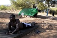 An illegal African immigrant rests at a makeshift camp in the Sidi Maafa woods in Oujda, near Morocco's Mediterranean coast, on September 10. Moroccan authorities have in the past few weeks clamped down on illegal migrants, kicking nearly 500 of them out of the country since early September