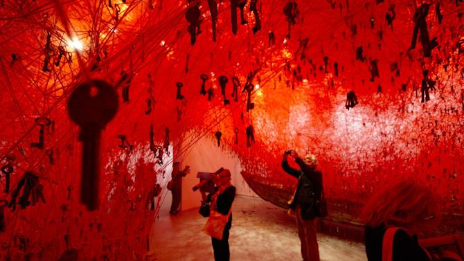 Thousands of keys hang in the Japanese pavilion part of Japanese artist Chiharu Shiota installation 'The Key in the Hand' at the 56th Biennale of Arts in Venice, Wednesday, May 6, 2015. (AP Photo/Domenico Stinellis)