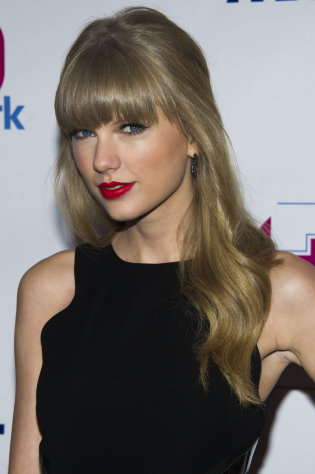 Taylor Swift attends Z100&#39;s Jingle Ball on Friday, Dec. 7, 2012 in New York. (Photo by Charles Sykes/Invision/AP)