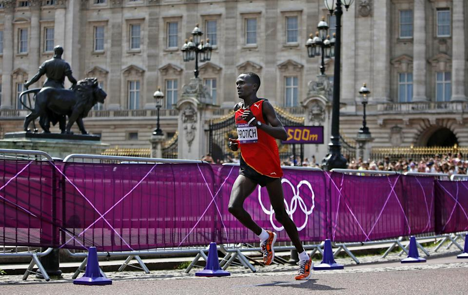 Uganda's Stephen Kiprotich runs past Buckingham Palace on his way to winning the men's marathon at the 2012 Summer Olympics in London, Sunday, Aug. 12, 2012. (AP Photo/Emilio Morenatti)