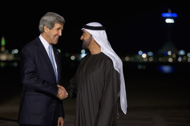 U.S. Secretary of State John Kerry and Abu Dhabi's Crown Prince Mohamed bin Zayed shake hands for a photograph before their dinner meeting at the Emirates Palace hotel in Abu Dhabi