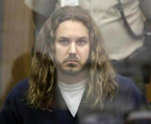 Lambesis, lead singer for the heavy metal band As I Lay Dying, looks on during his arraignment in San Diego North County court in California