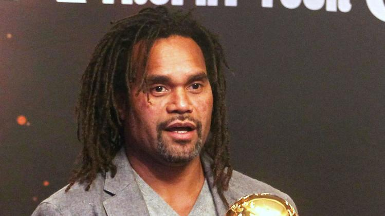 international soccer player Christian Karembeu holds the World Cup