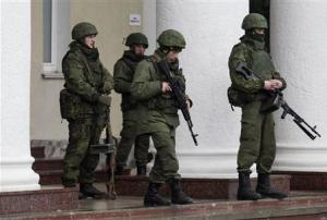 Armed men stand guard at the Simferopol airport in the Crimea region