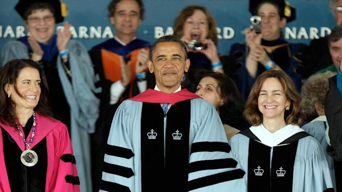 President Barack Obama arrives to deliver the commencement address to graduates at all-female Barnard College, on the campus of Columbia University, accompanied by Barnard President Debora L. Spar, left, in New York,  Monday, May 14, 2012. Barnard was the first college in New York City where women could receive the same liberal arts education available to men. (AP Photo/Richard Drew)