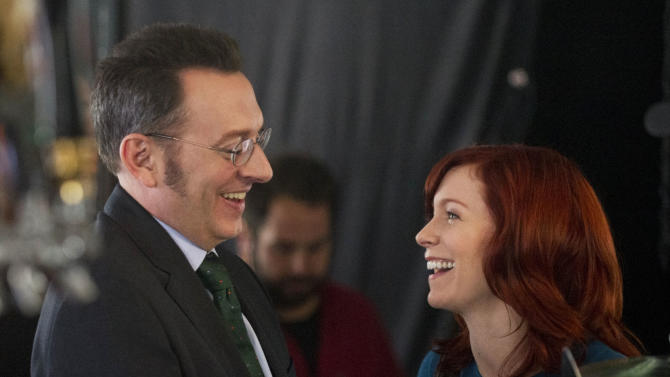 """This undated image released by CBS shows Michael Emerson, left, and Carrie Preston in a scene from """"Person of Interest.""""  Emerson has played a serial killer, a mysterious, villainous Island leader and currently stars as a billionaire computer genius on """"Person of Interest."""" But he says playing the romantic interest for his real life wife has been his most unsettling role. Emerson plays the off-beat Harold Finch in """"Person of Interest,"""" which airs Thursdays at 10 p.m. Eastern. His wife Carrie Preston has a recurring role as Finch's former fiance, who believes he is dead. (AP Photo/CBS, John Paul Filo)"""